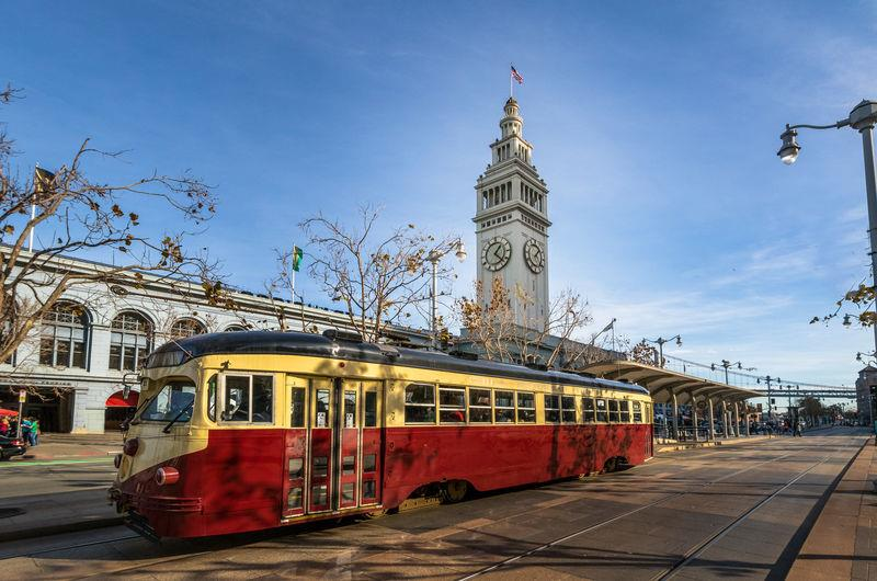 A tram in front of the San Francisco Ferry Building on The Embarcadero
